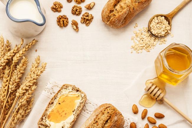 Rural breakfast - bread rolls, honey jar and milk