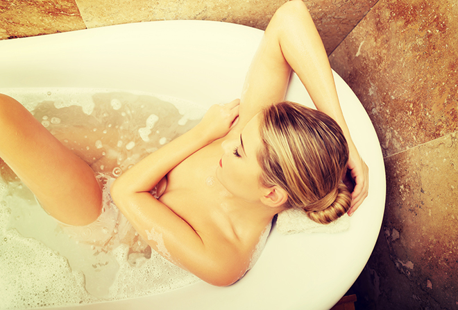 Above view of a woman relaxing in bath.
